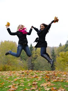 Free Two Autumn Girl Friends In A Park Jumping Royalty Free Stock Photography - 16489657