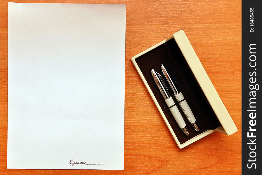 Pens and blank paper for signature