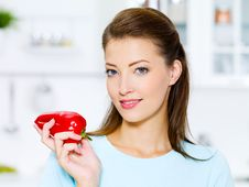 Beautiful Woman With Red  Pepper Royalty Free Stock Photo