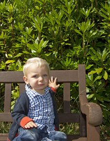 Free Young Boy Sat On Bench Stock Image - 16490311