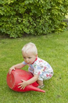 Free Toddler With Red Watering Can Stock Image - 16490411