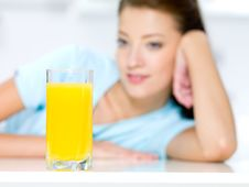 Free Girl With A Glass Of Fresh Orange Juice Royalty Free Stock Image - 16490566