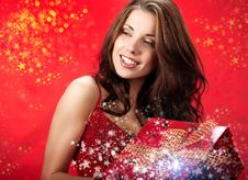 Free Sexy Girl  Holding A Gift In Magic Packing Royalty Free Stock Photography - 16491067
