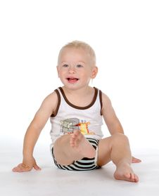 Free Beautiful Smiling Baby With Dirty Foot Royalty Free Stock Photography - 16493007