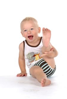 Free Beautiful Smiling Baby With Dirty Foot Stock Image - 16493021