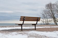 Empty Park Bench By A Lake In Winter Stock Image