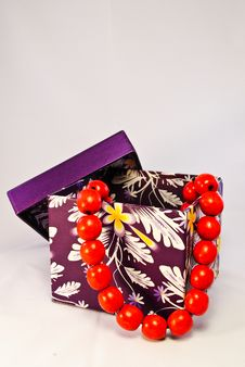 Free Purple Gift Box With Red Beads Stock Photos - 16497323