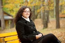 Free Smilling Woman Sitting On Bench Stock Image - 16497771