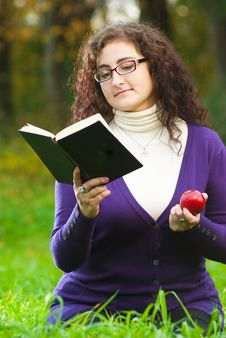 Free Woman Reads Book On Green Grass Stock Photography - 16497992