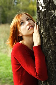 Free Girl In Red Dress Snuggle Up To Tree Stock Images - 16498734