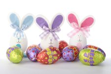 Easter Bunnies And Chicks With Eggs Over White Stock Photography