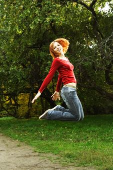 Young Girl In Red Shirt Jumping Outdoor Stock Images