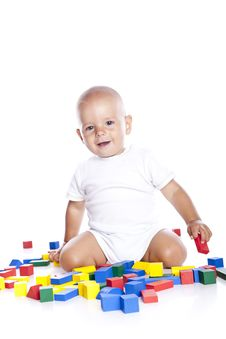 Free The Kid Plays With Cubes On A White Royalty Free Stock Image - 16499386