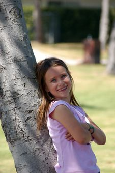 Free Girl Leaning On Tree Stock Images - 1650044