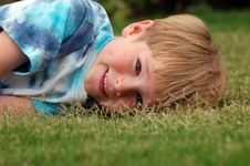 Free Boy Lying In Grass Royalty Free Stock Photo - 1650055