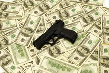Free American Dollars And Gun Stock Photo - 1651940
