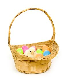 Free Baby Chick In A Basket With Plastic Easter Eggs Stock Image - 1653791