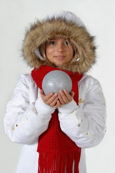 Girl With The Christmas Ball Royalty Free Stock Photography