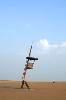 On The Beach,a Watchtower Under Blue Sky Stock Images