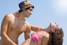Free Summer Couple Tanning On The Beach Stock Photo - 1658690