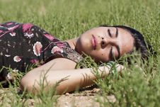 Free Girl Sleeping On Grass Stock Photo - 16500090