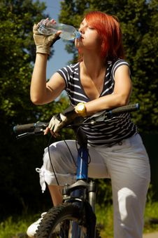 Free Young Adult Smiling Biker Woman On Mounting Bike Royalty Free Stock Photos - 16501478