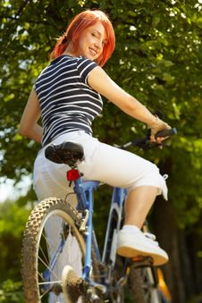Free Young Adult Smiling Biker Woman On Mounting Bike Royalty Free Stock Image - 16501546