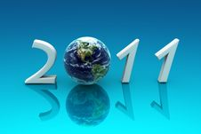2011 Earth, Reflected In A Blue Background Royalty Free Stock Image