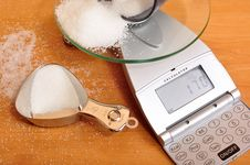 Free Weighing Sugar On Scale. Stock Images - 16504984