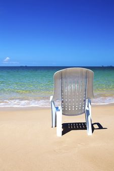 Free Plastic Chair Looking Out To The Ocean. Royalty Free Stock Images - 16505569
