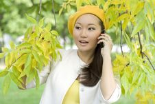 Girl Talking By Phone Stock Photo