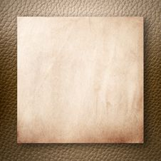 Free Old Paper On Light Brown Leatherette Royalty Free Stock Photography - 16506887