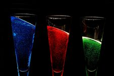 Free Champagne Glasses Filled With Coloured Sparkly Win Stock Images - 16509104