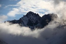 Free Rocky Mountains In The Clouds Royalty Free Stock Photo - 16509535