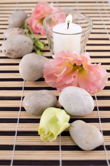 Free Stones With Candle On Bamboo Mate Royalty Free Stock Photo - 16509995