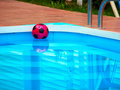 Free Ball Is Floating In Swimming Pool Stock Photography - 16517442
