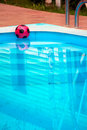 Free Ball Is Floating In Pool Near House Stock Photography - 16517472
