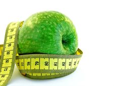 Free Green Apple With Measuring Tape Stock Photography - 16510802