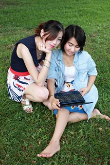 Free Two Beautiful Girl On A Laptop Computer Outdoors. Stock Photography - 16511932