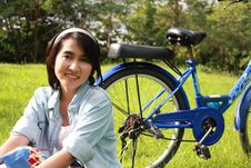 Free Woman With A Bike Outdoors Smiling Stock Images - 16511974
