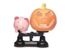 Free Piggybank And Pumpkin On Scales Stock Photography - 16512282