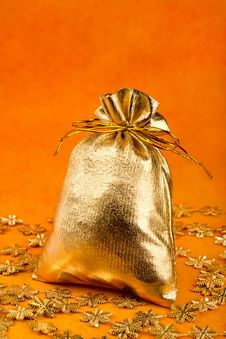 Free Golden Gift Sack And Golden Snowflakes Royalty Free Stock Photography - 16512967