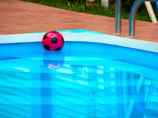 Ball Is Floating In Swimming Pool Stock Photography