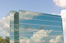 Free Mirrored Office Building Reflecting The Clouds Royalty Free Stock Image - 16519386