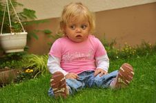 Free Child Girl Sitting On The Grass Royalty Free Stock Photo - 16519655