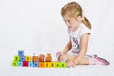 Free Happy  Girl Playing With Colourful Wooden Blocks Royalty Free Stock Image - 16520986