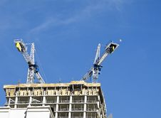 Free Two Cranes Atop New Construction Royalty Free Stock Photo - 16521505