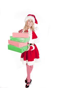 Free Santas Helper Holding Presents Full Body Stock Image - 16521731
