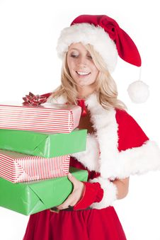 Santas Helper Holding Presents Looking Down Stock Photography