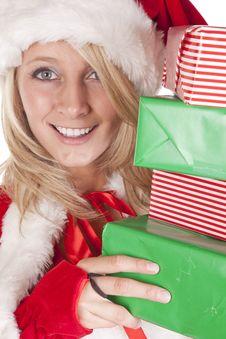Free Santas Helper Peeking Around Presents Royalty Free Stock Image - 16521846